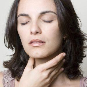 Woman-Touching-Thyroid-Hypothyroidism-Weight-Gain-300x300