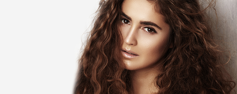 Beautiful-young-woman-with-long-curly-hairstyle-for-website