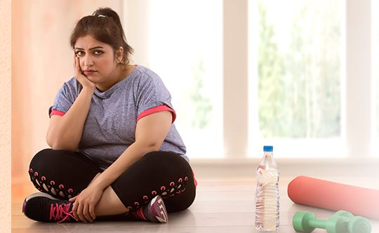 Featured-image-Depressed-overweight-woman-sitting