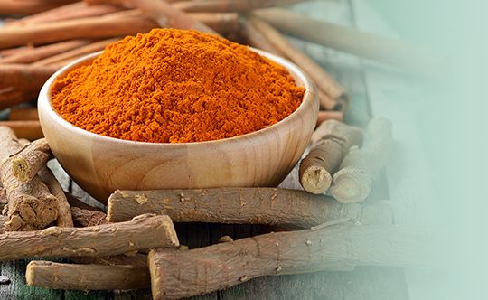Featured-image-licorice-roots-cinnamon-sticks-turmeric-on-wooden
