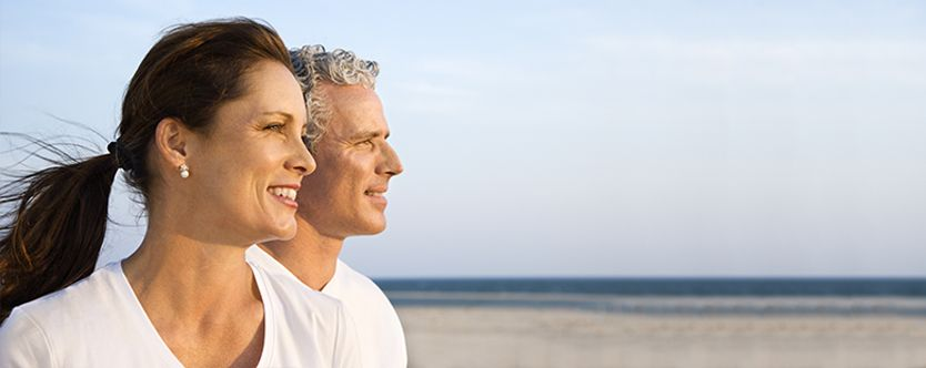 Featured-image- smiling-middle-aged-couple-on beach-for-website